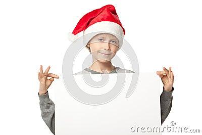 Boy in Santa hat with blank board