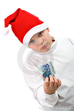 Boy in Santa hat with paper money isolate on white