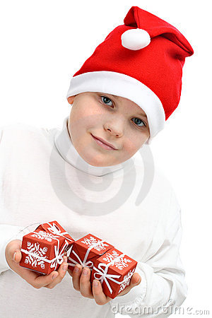 Boy in Santa s red hat holding Christmas presents