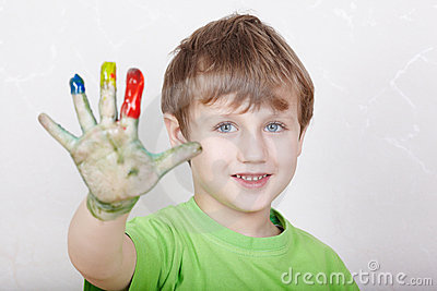 Boy with satisfied face shows his right palm