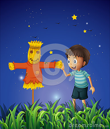 A boy and a scarecrow at the ricefield