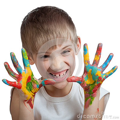 Boy scares their hands stained with paint