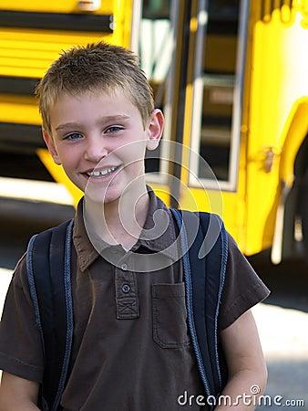 Boy by school bus