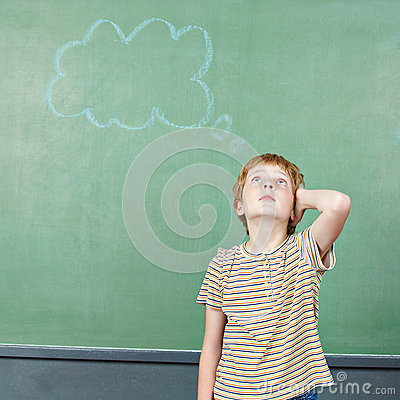 Boy in school thinking with thought