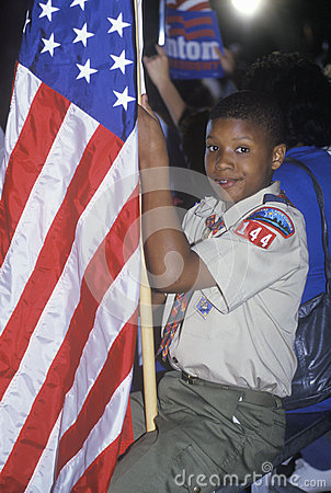 Boy Scout with an American flag Editorial Stock Image