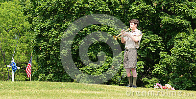 Boy scout plays tap on memorial day Editorial Image