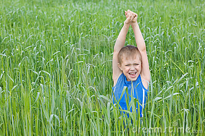 Boy screaming in the grass