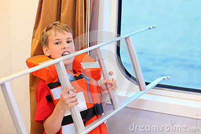 Boy screams and holds ladder