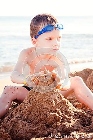 The boy on the sea coast