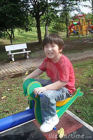 Boy on seesaw