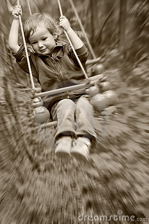Boy shakes on a swing