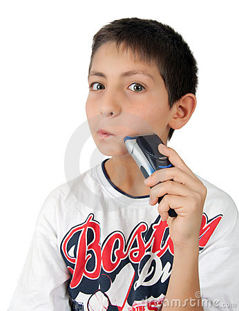 Boy shaving cheek with his razor and fun
