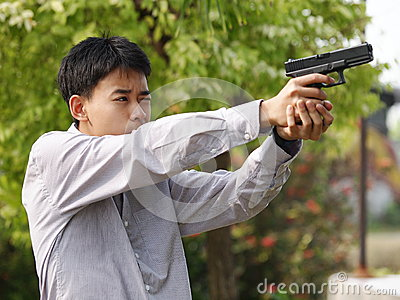 Boy shooting air soft ball bullet gun