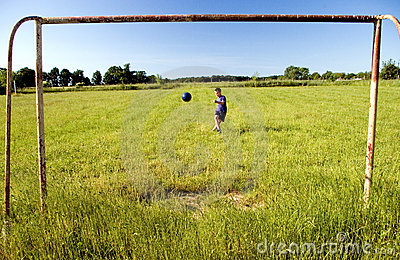 Boy shooting at goal