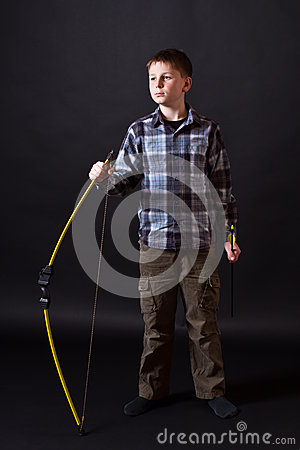 Boy shoots a bow
