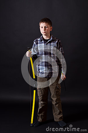Boy Shoots A Bow Stock Photo - Image: 28231120