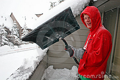 Boy shovelling snow