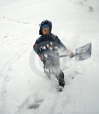 Boy shovels snow
