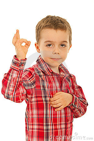 Boy showing okay sign hand gesture