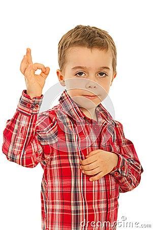 Boy showing okay sign hand gesture