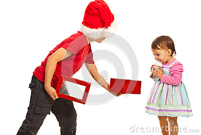 Boy showing to girl open box