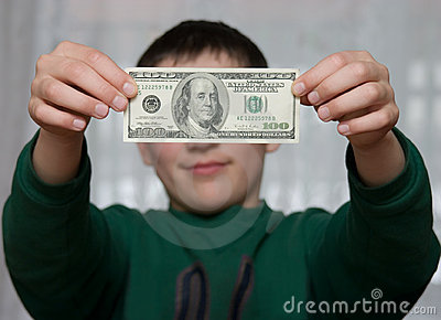 A boy shows 100 dollars
