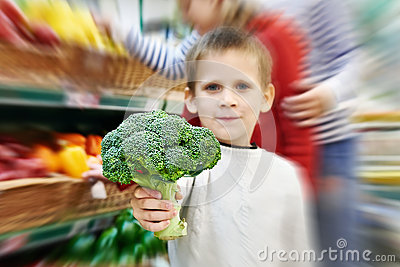 Boy shows broccoli Stock Photo