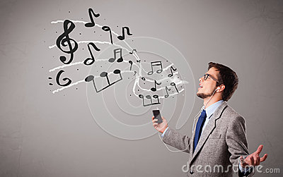 boy singing and listening to music