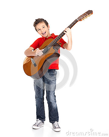 Boy sings and plays on the acoustic guitar