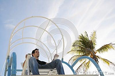Boy sitting in beach chair