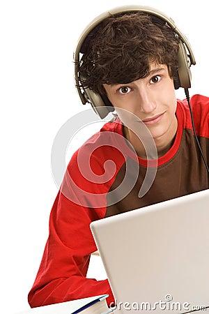 Boy sitting behind desk