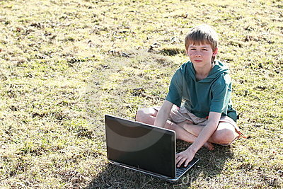Boy sitting with a computer