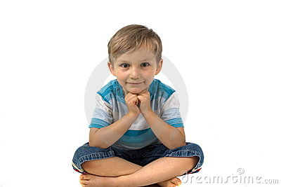 Boy sitting cross-legged