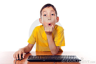 Boy sitting in front of computer