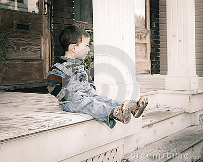 Boy sitting on gallery