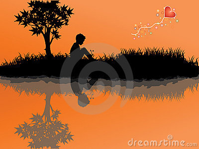 The boy sitting on a grass ,