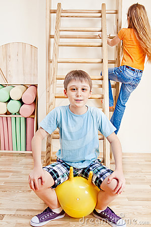 Boy sitting on gymnastic ball