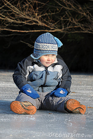 Boy sitting on ice
