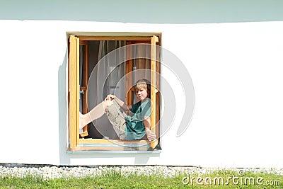 Boy sitting on the window