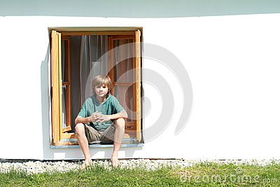 Boy sitting in the window