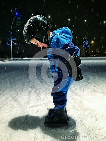 Free Boy Skating On Outdoor Rink Royalty Free Stock Photos - 38491568