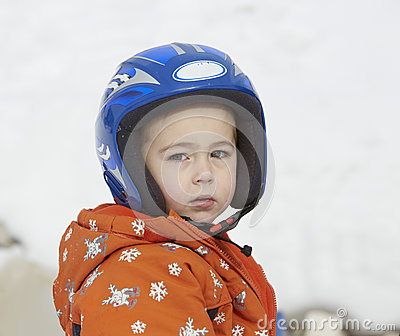 Boy in ski helmet, at winter vacation
