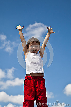 Boy on sky background