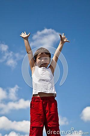 Boy on sky background
