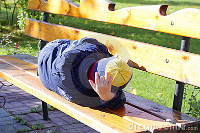 Boy sleeping on bench