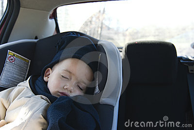 Boy sleeping in car