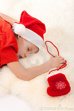 Boy sleeping and dreaming about gifts