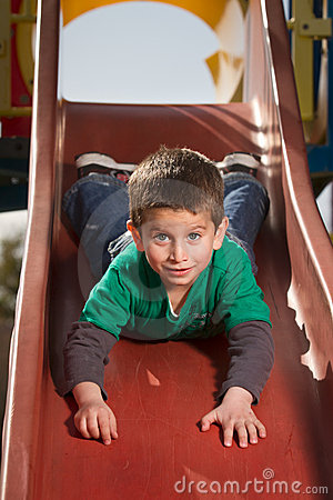 Boy On Slide Royalty Free Stock Photo - Image: 18556615