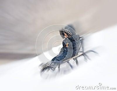 Boy sliding snowy hill