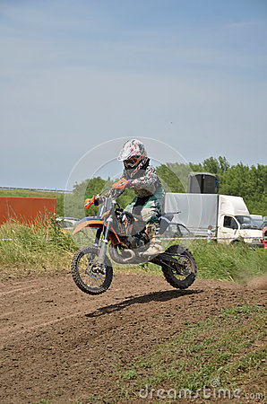 Boy on a small motorcycle MX jumps in descent Editorial Stock Photo
